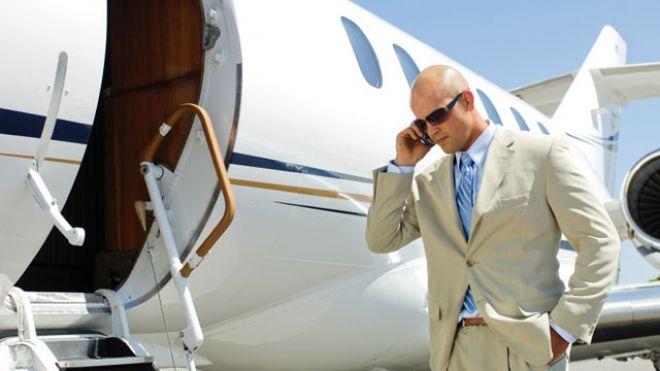 airplane private jet businessman phone